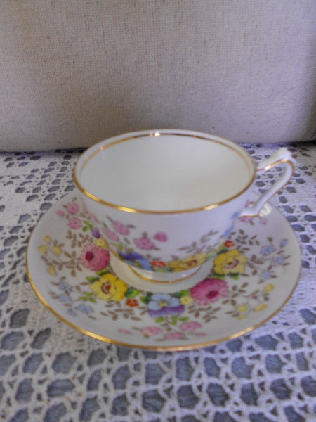 Cup and Saucer ...  WHite with Pink